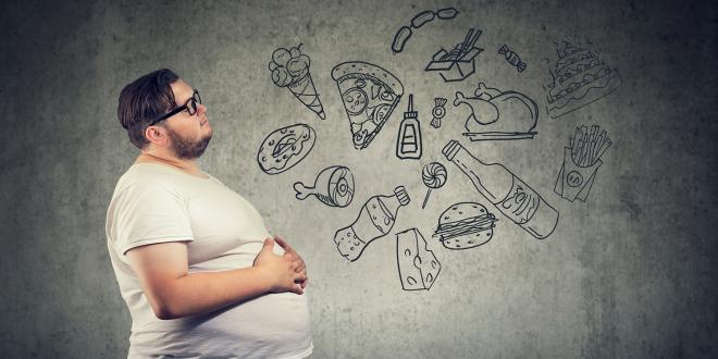 an overweight man thinking about candy and junk food